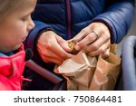 mother opening a roasted... | Shutterstock . vector #750864481