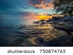 sunset sea boulders beach... | Shutterstock . vector #750874765