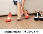 young woman choosing shoes in... | Shutterstock . vector #750892579