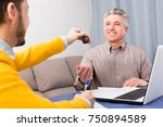 Small photo of Adult man and manager signed contract car hire at home and hand over keys