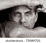 Distressed Man Framing His Fac...