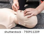 cpr training outdoors.... | Shutterstock . vector #750911209