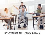 a colleague rolls a person in a ... | Shutterstock . vector #750912679