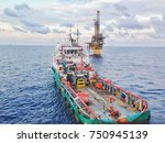 supply boat approaching the rig ... | Shutterstock . vector #750945139