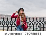 good looking girl in jeans and... | Shutterstock . vector #750958555