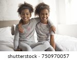 the two little african american ... | Shutterstock . vector #750970057