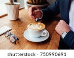 young handsome guy in a suit... | Shutterstock . vector #750990691
