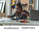 fixing mechanic toy car | Shutterstock . vector #750997051