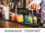 bartender hand at multicolored... | Shutterstock . vector #751047637