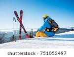 rearview shot of a skier... | Shutterstock . vector #751052497