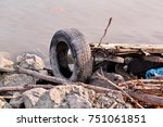 used car tire left in nature.... | Shutterstock . vector #751061851