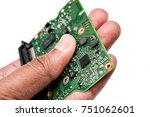 chipset in hand of hard drive | Shutterstock . vector #751062601