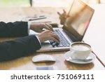 businessman using notebook at... | Shutterstock . vector #751069111
