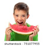 Young Boy Eating Watermelon On...
