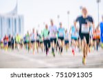 marathon runners in the city  | Shutterstock . vector #751091305