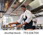 smiling chef cooking food at... | Shutterstock . vector #751106704