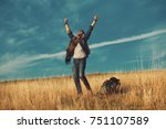young hiker enjoys a sunny day... | Shutterstock . vector #751107589