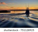 a sport fishing boat heading...