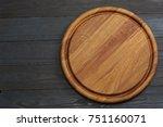 round wooden plate on dark... | Shutterstock . vector #751160071