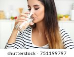 beautiful young woman drinking... | Shutterstock . vector #751199797