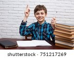 boy with raised hand has an...   Shutterstock . vector #751217269