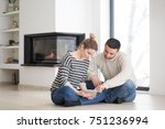 young couple on the floor in... | Shutterstock . vector #751236994