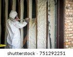 worker spraying open cell spray ...   Shutterstock . vector #751292251