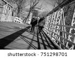 mother and daughter walking on... | Shutterstock . vector #751298701