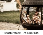 outdoor fire pit with roaring... | Shutterstock . vector #751300135