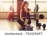 woman exercise workout in gym... | Shutterstock . vector #751329697