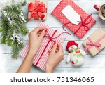 female hands wrapping christmas ... | Shutterstock . vector #751346065