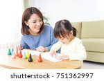 a parent and child painting a... | Shutterstock . vector #751362997
