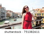 beautiful girl with red dress... | Shutterstock . vector #751382611