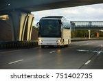 white tourist bus goes on the