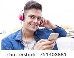 young teenager listening to... | Shutterstock . vector #751403881