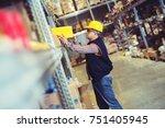worker in warehouse preparing... | Shutterstock . vector #751405945