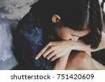 sad woman hug her knee and cry... | Shutterstock . vector #751420609