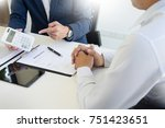 salesman holding a key and... | Shutterstock . vector #751423651