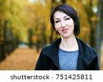girl portrait  yellow leaves on ... | Shutterstock . vector #751425811