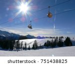 sunny ski area with ski lifts... | Shutterstock . vector #751438825