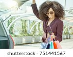 shopping girl curly hair... | Shutterstock . vector #751441567