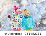 kids playing in snow. children... | Shutterstock . vector #751452181