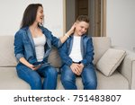 happy mother and son sitting on ... | Shutterstock . vector #751483807