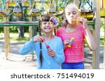 kids with soap bubbles | Shutterstock . vector #751494019