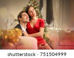 sweet couple sitting on a sofa  ... | Shutterstock . vector #751504999