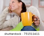 close up of yellow cup of tea... | Shutterstock . vector #751511611