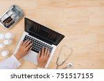 doctor working on laptop... | Shutterstock . vector #751517155