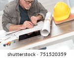 architect working on plans at... | Shutterstock . vector #751520359