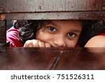 little girl looks through the... | Shutterstock . vector #751526311