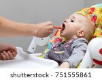 mother giving cough syrup with... | Shutterstock . vector #751555861